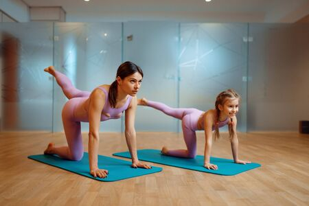 Photo for Mother and daughter doing stretching exercise - Royalty Free Image