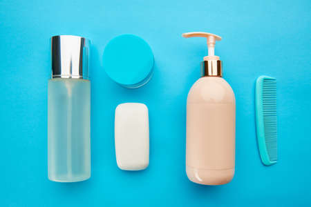 Photo for Care products on blue background, nobody - Royalty Free Image