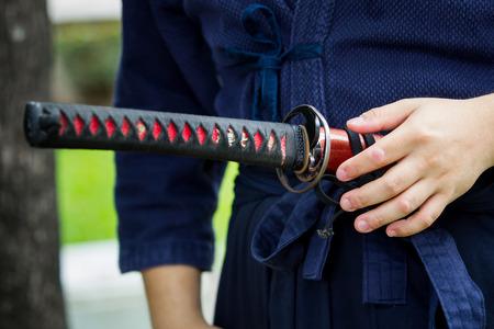 Foto de The treaditional Japanese sword Katana sword holding in Samurai hand prepare to flighting. - Imagen libre de derechos