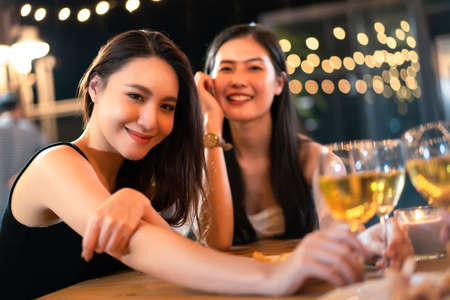 Photo pour Happy Asian women enjoy celebrating a new year eve festival together with a lot of drink and food. New Year Eve party concept. - image libre de droit