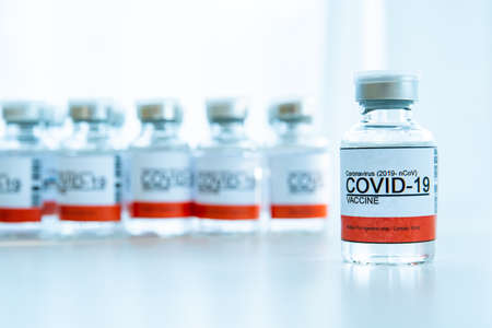 Foto de Coronavirus - 2019-nCoV or COVID-19 vaccine bottles for injection use only. Urgent vaccine research and production use in COVID-19 - Coronavirus disease. COVID-19 vaccine close up with copyspace. - Imagen libre de derechos