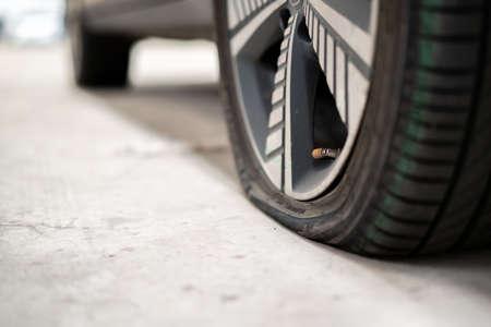 Photo pour Close up photograph of damaged wheel - flat tire of an accident vehicle. A car have an accident on a wheel. - image libre de droit