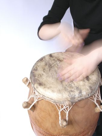 playing African kpalogo drum
