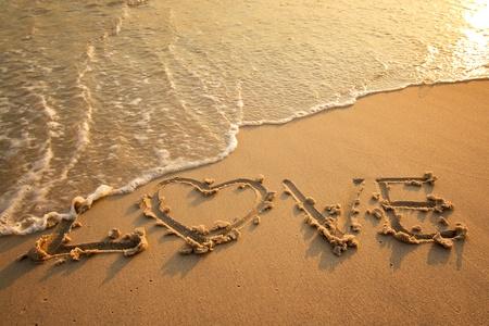 Heart love drawn on sand