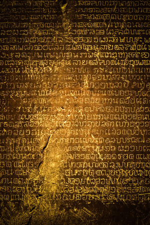 Ancient Thai writing chiseled on stone