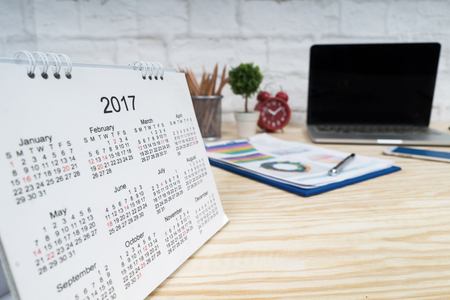 2017 Calendar on wooden table, working place with copy space.