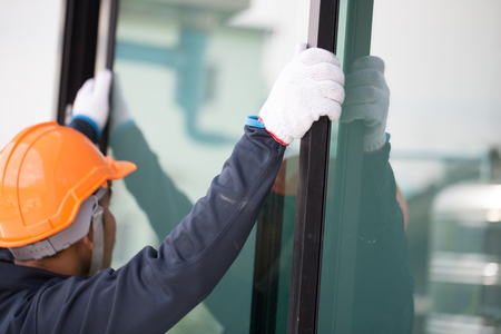 Photo for The technician's hands will install aluminum windows. - Royalty Free Image