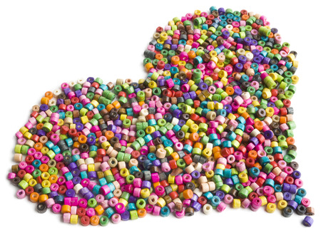 Colorful wooden beads heart on white background