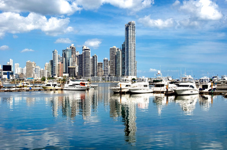 Photo for Luxury yachts on the background of skyscrapers with water reflection - Panama City - Royalty Free Image