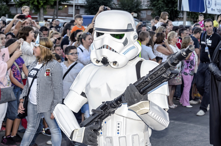 TORREJON DE ARDOZ, SPAIN - SEPTEMBER 12th 2015: VII Training day of spanish garrison 501st legion, -Star wars-. Charitable parade in favor of -the red cross-. Unidentified man disguised of -Stormtrooper ANH Stunt-, by the streets of Torrejon de Ardoz, on