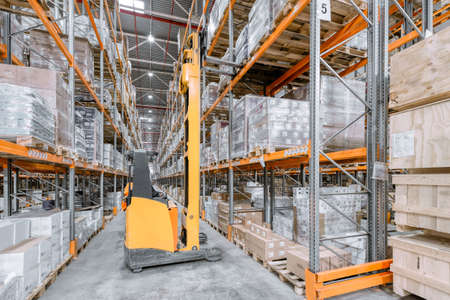 Photo for Large warehouse. Tall and long metal racks filled with various boxes, containers and drawers - Royalty Free Image