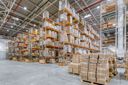 Photo for Large warehouse. Tall metal shelves - Royalty Free Image