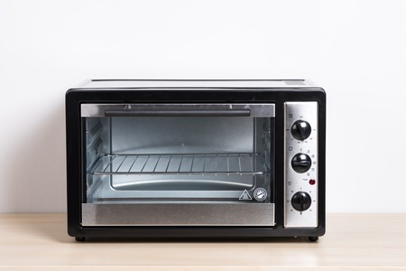 Photo for small electric oven isolated in the kitchen - Royalty Free Image