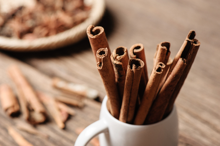 fragrant cinnamon sticks in white cup