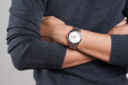 closeup luxury watch on wrist of man