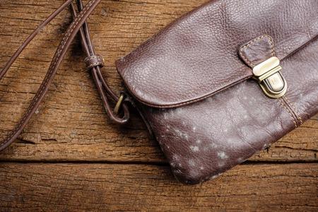 Photo pour mold on old brown leather bag - image libre de droit