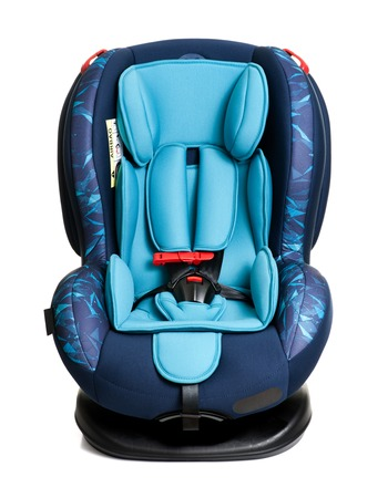 Foto de blue child safety seat isolated over white background, seat designed specifically to protect children from injury or death during collisions. - Imagen libre de derechos