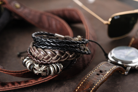 closeup leather bracelets for men, casual style of men accessories. Shallow depth of field.