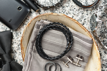 closeup black braided leather bracelet for men, casual style of men accessories.