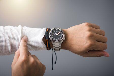 Photo pour closeup luxury men watch with black dial and stainless steel bracelet on wrist of man. - image libre de droit