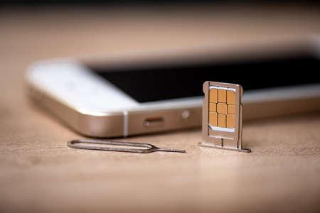 Photo pour SIM card for smart phone. Changing the SIM card. - image libre de droit