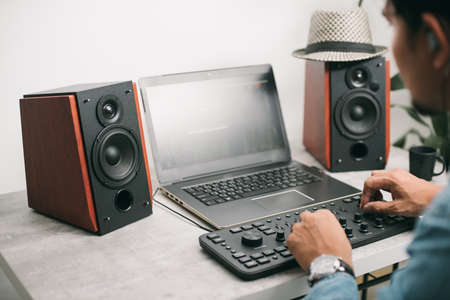 Photo for Workstation with speakers and computer in studio. Desktop in home office. Selective focus on the speaker. - Royalty Free Image