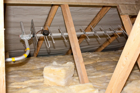 A view of attic insulation within a typical household.