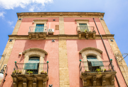 Photo for A view from the ground up of an old building in Sicily, Italy. - Royalty Free Image