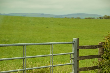 A gate to a field to keep animals protected.