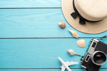 Photo pour Summer holiday background, Travel and vacation items on wooden table. Top view - image libre de droit