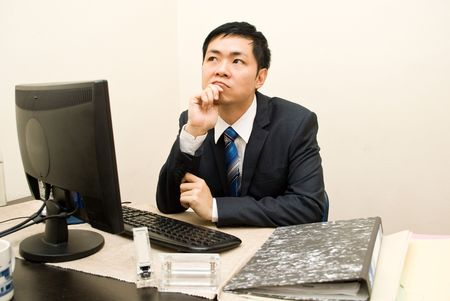 Asian businesman thinking