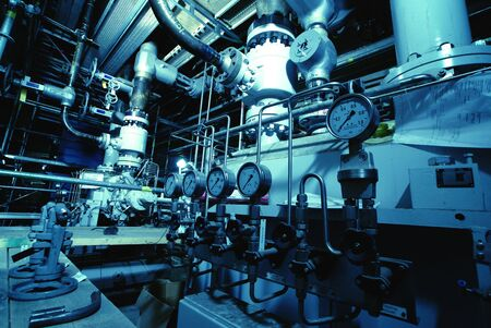Pressure gauges connected with many metallic pipes, interior of water treatment plant