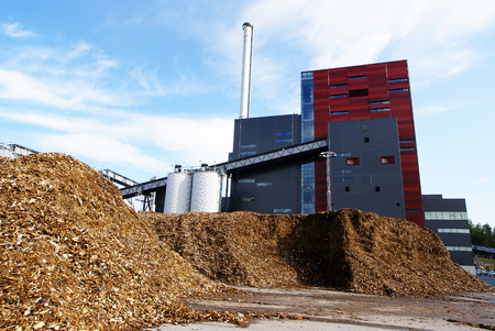 Photo for bio power plant with storage of wooden fuel (biomass) against blue sky - Royalty Free Image