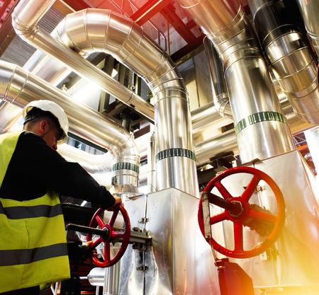Photo pour modern factory worker turning valve - image libre de droit