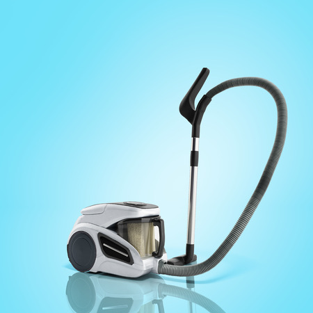 3d render of vacuum cleaner on blue background image