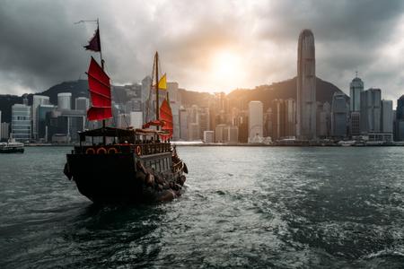 Foto für Hong Kong City skyline with tourist sailboat. View from across Victoria Harbor Hong Kong. - Lizenzfreies Bild