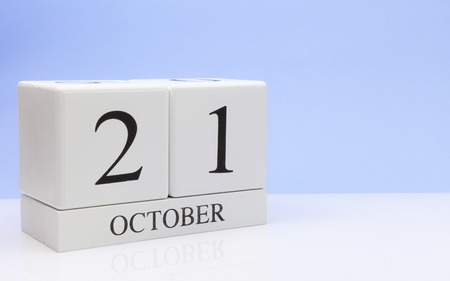Photo for October 21st. Day 21 of month, daily calendar on white table with reflection, with light blue background. Autumn time, empty space for text - Royalty Free Image