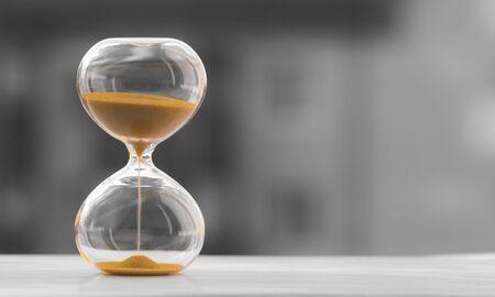 Photo pour Hourglass on a black white blurred background. Time is money. - image libre de droit