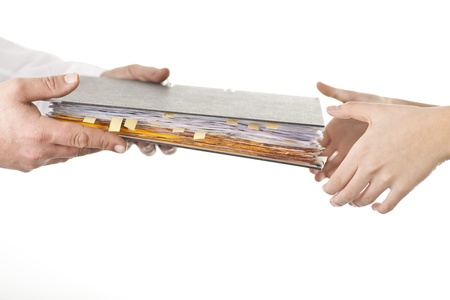 Photo pour Male give file folder of paperwork to another person - image libre de droit