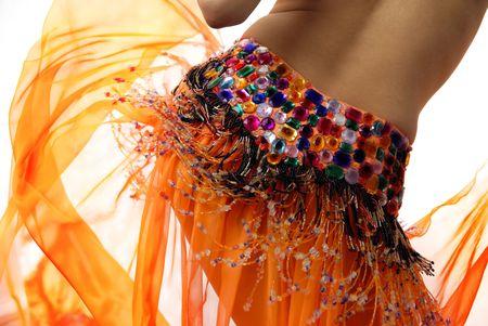 Foto de Belly of the woman dancing in the orange dancing dress - Imagen libre de derechos
