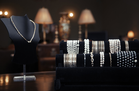 Assortment of jewelry in a jewelry shop. Close-up view