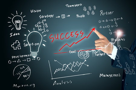 business hand pointing program of success
