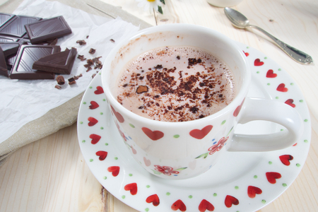 Hot sweet cocoa drink with milk and chocolate