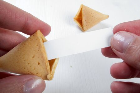 Photo pour Fortune cookies in hands with advices, motivation mottos and blank space for copy - image libre de droit