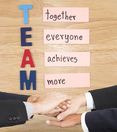 Photo pour Business partners making pile of hands for TEAM (Business Concept) - image libre de droit