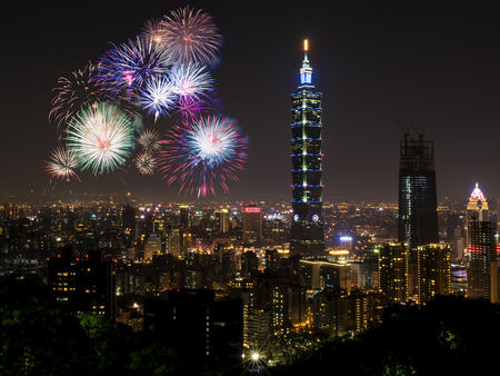 Photo for Firework with cityscape nightlife view of Taipei. Taiwan city skyline at twilight time, public scene from view point. - Royalty Free Image