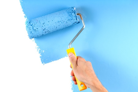 Photo for blue color painting wall with roller - Royalty Free Image