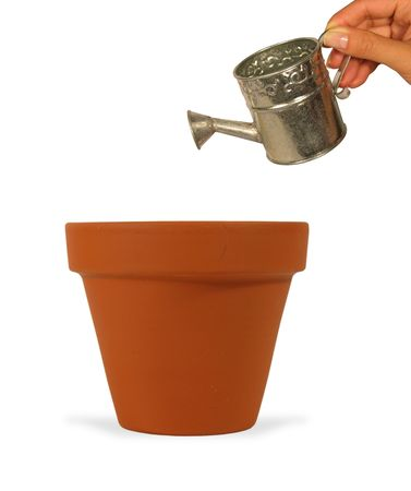 Woman holding a miniature watering can