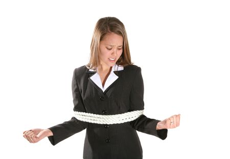 A business woman frustrated at being tied with rope