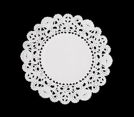 Photo pour A decorative round doily isolated over black - image libre de droit